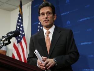House Majority Leader Cantor leaves after a news conference