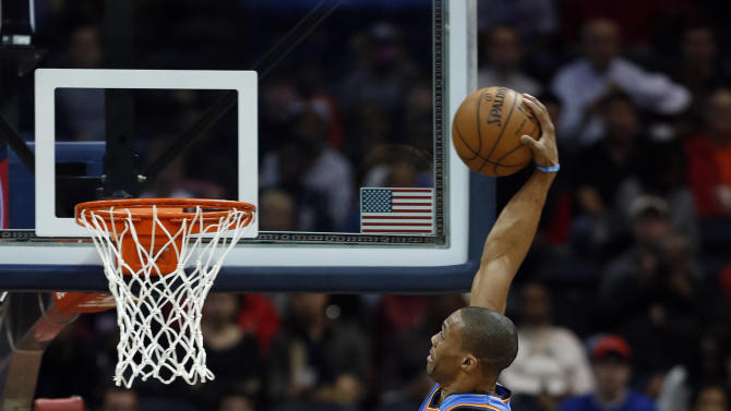 Oklahoma City Thunder point guard Russell Westbrook (0) scores as Atlanta Hawks' Jeff Teague (0) and  Al Horford (15) defend in the first half of an NBA basketball game on Wednesday, Dec. 19, 2012, in Atlanta. (AP Photo/John Bazemore)