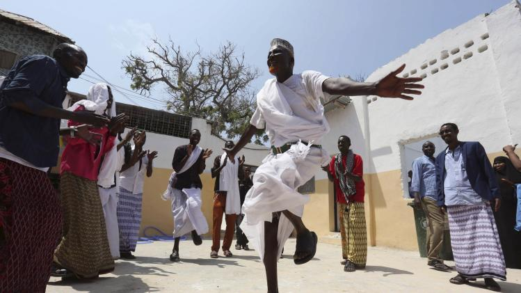 A man performs a traditional dance in celebration after attending Eid al-Fitr prayers to mark the end of the fasting month of Ramadan in Somalia's capital Mogadishu