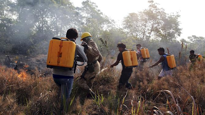 Firefighters and indigenous people from the Kamayura tribe attend a training to combat wildfire in the Xingu National Park, Mato Grosso, Brazil