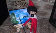 Painting Bob Ross&#39;s happy trees is a little known hobby of the Elf on the Shelf.