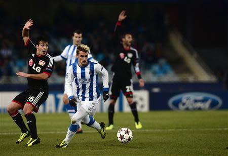 Real Sociedad's Antoine Griezmann challenges Bayer Leverkusen's Giulio Donati during their Champions League soccer match at Anoeta stadium in San Sebastian