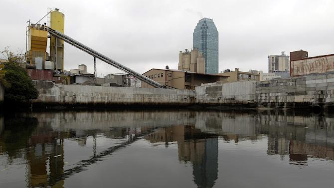 This Oct. 24, 2012 photo shows a factory on the banks of Dutch Kills, a navigable tributary of Newtown Creek in New York. Newtown Creek was added to the Superfund National Priorities List in 2010 for pesticides, metals, PCBs and volatile organic compounds. New York, New Jersey and EPA officials say toxic sites are OK after Superstorm Sandy, but The Associated Press has found that few actual tests have been done. (AP Photo/Mary Altaffer)