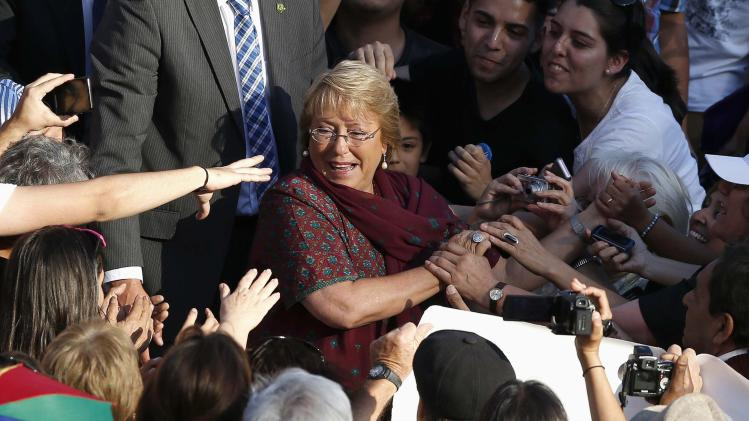 Chilean presidential candidate Bachelet of Nueva Mayoria is welcomed by supporters as she arrives at closing campaign rally in Santiago