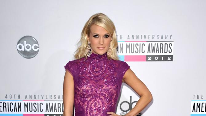 Carrie Underwood arrives at the 40th Anniversary American Music Awards on Sunday, Nov. 18, 2012, in Los Angeles. (Photo by John Shearer/Invision/AP)