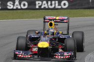 Red Bull driver Sebastian Vettel, of Germany, steers his car during the third training session ahead of the Brazilian F1 Grand Prix on the Interlagos racetrack in Sao Paulo, Brazil, Saturday Nov. 26, 2011. Sebastian Vettel was fastest in the final practice Saturday, qualifyinging for Sunday's Brazilian Grand Prix. (AP Photo/Andre Penner)