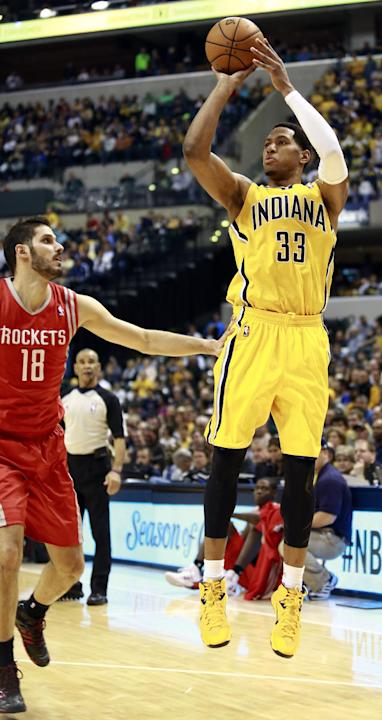 Indiana Pacers forward Danny Granger (33) shoots while guarded by Houston Rockets forward Omri Casspi (18) in the second half of an NBA basketball game in Indianapolis, Friday, Dec. 20, 2013
