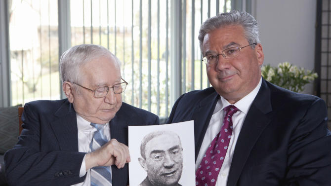 This handout photo provided by the United States Holocaust Memorial Museum, taken earlier this year outside of Philadelphia, shows Sol Finkelstein, 85 of Vineland, N.J., and his son, Joseph Finkelstein of Bala Cynwyd, Pa. They are holding the first photograph Sol Finkelstein has seen of his father, Jakob Finkelstein, since the two were separated in a concentration camp during the Holocaust. With help from the U.S. Holocaust Memorial Museum, they learned that Jakob Finkelstein had survived until the camp was liberated, and they found his burial spot in Austria. (AP Photo/Miriam Lomaskin, United States Holocaust Memorial Museum)