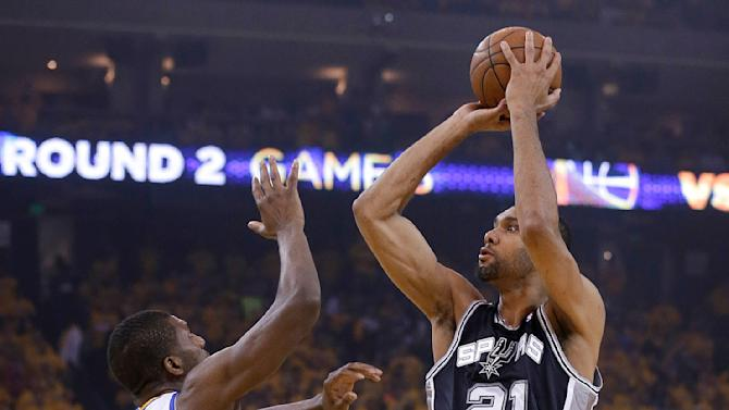 San Antonio Spurs forward Tim Duncan (21) shoots against Golden State Warriors center Festus Ezeli (31) during the first quarter of Game 3 of a Western Conference semifinal NBA basketball playoff series in Oakland, Calif., Friday, May 10, 2013. (AP Photo/Jeff Chiu)
