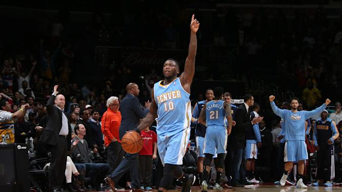 Faried has key block, dunk as Nuggets edge Wizards