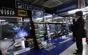 A shopper looks at Panasonic Corp's Viera televisions displayed at an electronics retail store in Tokyo