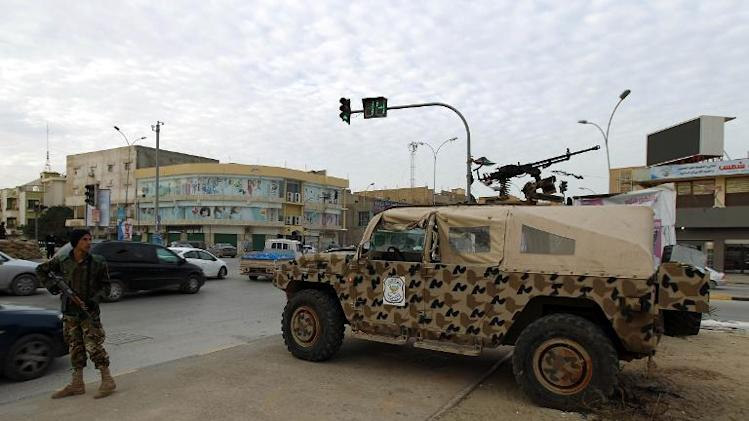 A Libyan soldier and army vehicle are deployed in the streets of central Benghazi on November 19, 2013