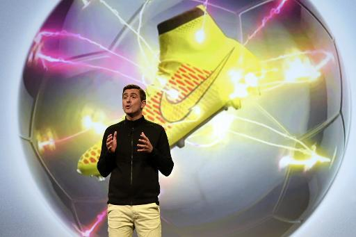 "Vice President of Nike's Sport Performance Footwear Phil McCartney presents the new ""Magista"" football boot in Barcelona on March 6, 2014"