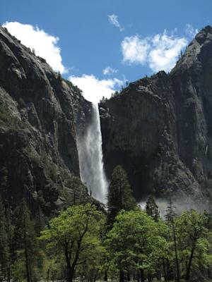 In this photo taken Thursday, May 26, 2011, Bridalveil Falls is seen in Yosemite National park. A historic Sierra Nevada snowpack is making Yosemite National Park's springtime spectacle of cascading waterfalls especially beautiful and dangerous as the park welcomes visitors for one of the busiest weekends of the year.  (AP Photos/Tracie Cone)