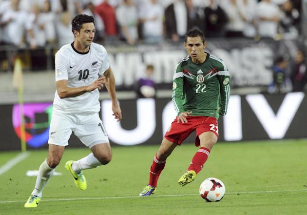 New Zealand's Rory Fallon, left and Mexico's Paul Aguilar vie for the ball during their World Cup qualifying soccer match at Westpac Stadium, in Wellington, New Zealand, Wednesday, Nov. 20, 2013. Mexi