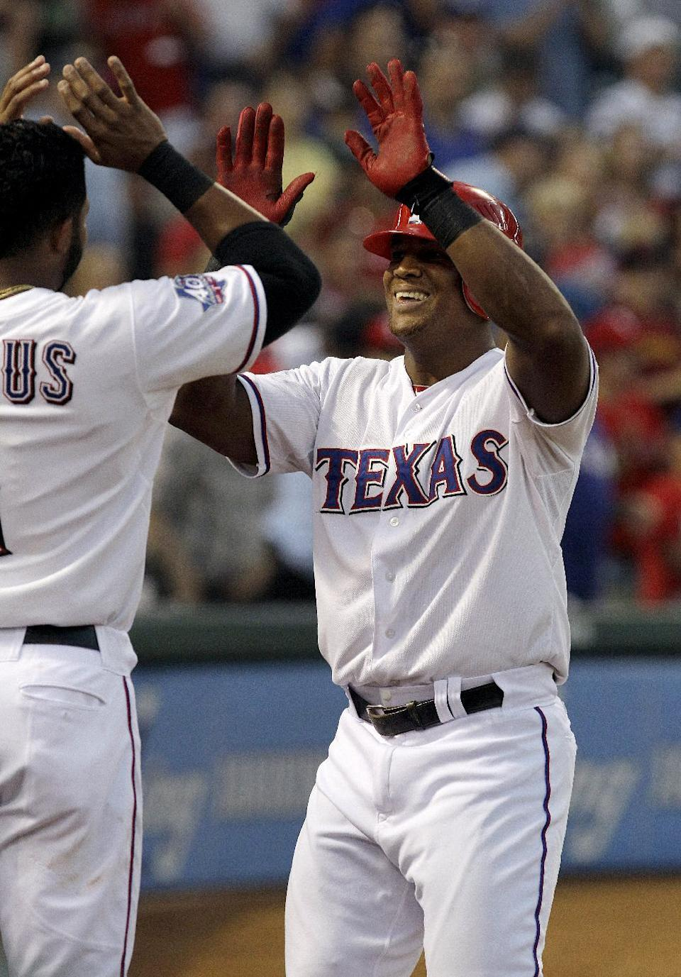 Texas Rangers' Adrian Beltre, right, celebrates with Elvis Andrus after Beltre's home run during the fourth inning of a baseball game against the Baltimore Orioles, Wednesday, Aug. 22, 2012, in Arlington, Texas. (AP Photo/LM Otero)