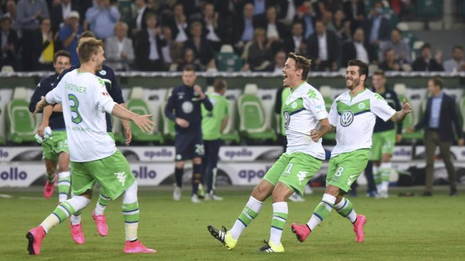 VfL Wolfsburg players celebrate after defeating Bayern Munich in a penalty shoot-out to win German Supercup in Wolfsburg