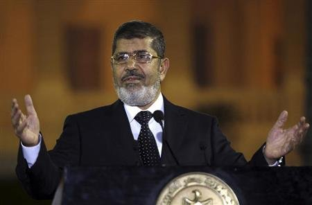 Egyptian President Mohamed Mursi speaks during a news conference with Turkish President Abdullah Gul (not pictured) after their meeting at Presidential Palace &quot;Qasr Al Quba&quot; in Cairo February 7, 2013. REUTERS/Amr Abdallah Dalsh