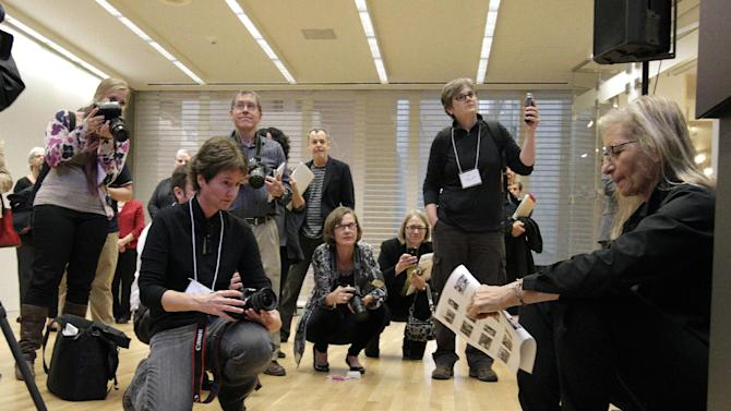 """Annie Leibovitz, right, waits to be introduced for the opening of her exhibition at the Wexner Center for the Arts Friday, Sept. 21, 2012, in Columbus, Ohio. Leibovitz's exhibition features work from her """"Master Set,"""" an authoritative edition of 156 images. (AP Photo/Jay LaPrete)"""