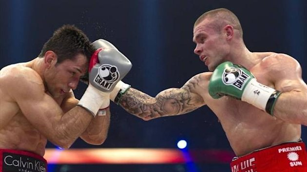 Martin Murray throws a right at Felix Sturm