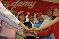 Newly appointed AirAsia CEO of Malaysian Operations Aireen Omar (third left) joins Group CEO Tony Fernandes (second left), and other top officials at a ceremony in Sepang, outside Kuala Lumpur on Monday. Fernandes on Monday said he was handing over his role as head of Malaysia operations to shift focus to oversee the budget carrier&#39;s regional expansion