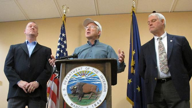 U.S. Interior Secretary Ken Salazar speaks during a news conference Monday, Aug. 13, 2012, in Anchorage, Alaska. On the left is Mike Pool, acting director of the Bureau of Land Management, and Bud Cribley, right, Alaska director for the BLM. Salazar said the proposed plan for the National Petroleum Reserve-Alaska will leave more than half of the 23-million acre reserve available for development or construction of infrastructure, such as a pipeline that could carry oil from leases in the Chukchi Sea to the trans-Alaska pipeline. (AP Photo/Mark Thiessen)