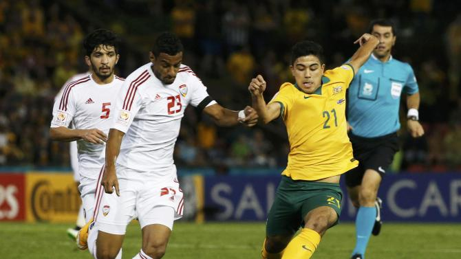 Australia's Massimo Luongo fights for the ball with UAE's Mohamed Ahmad Gharib during their Asian Cup semi-final soccer match at the Newcastle Stadium in Newcastle