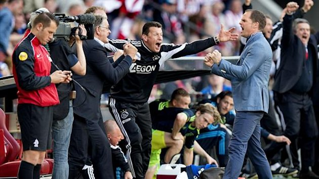 NETHERLANDS, Eindhoven : Ajax Amsterdam coach Frank de Boer (2nd R) celebrates on April 14, 2013 after his team won its Dutch League match against PSV Eindhoven in Eindhoven. AFP