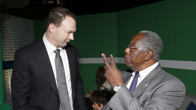 """Producer Thomas Tull and baseball player Hank Aaron arrive at the LA premiere of """"42"""" at the TCL Chinese Theater on Tuesday, April 9, 2013 in Los Angeles. (Photo by Todd Williamson /Invision/AP)"""