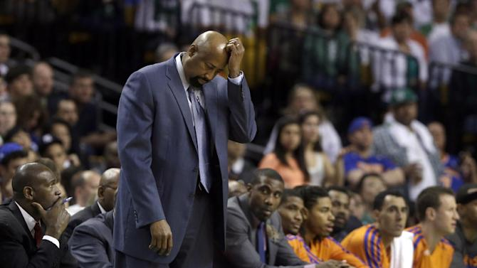 New York Knicks head coach Mike Woodson, left, reacts near the bench during the second half against the Boston Celtics in Game 4 of a first round NBA basketball playoff series, Sunday, April 28, 2013, in Boston. The Celtics won 97-90 in overtime. (AP Photo/Elise Amendola)