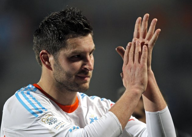Olympique Marseille's Gignac reacts after scoring against Troyes during their French Ligue 1 soccer match in Marseille