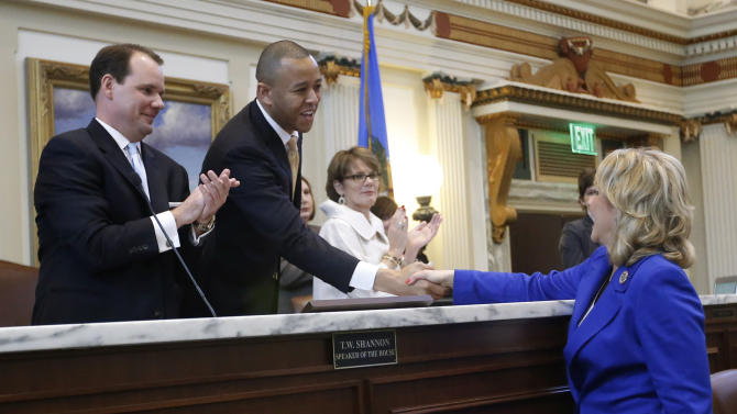 File - In this Feb 4, 2013 file photo, Oklahoma Gov. Mary Fallin, right, greets Speaker of the Oklahoma House, T.W. Shannon, center, R-Lawton, as Lt. Gov. Todd Lamb, left, looks on, in Oklahoma City. President Barack Obama may have won re-election, but conservative Republicans still control many of the states, and legislative leaders in some have established special states' rights committees to handle a surge of bills rejecting federal authority. (AP Photo/Sue Ogrocki, File)