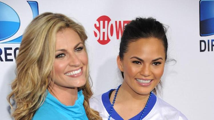 From left, Erin Andrews and Chrissy Teigen arrive at DIRECTV's Seventh Annual Celebrity Beach Bowl, on Saturday, Feb. 2, 2013 in New Orleans. (Photo by Evan Agostini/Invision/AP)