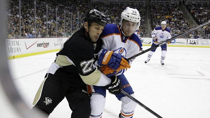 Pittsburgh Penguins' Craig Adams (27) skates next to Edmonton Oilers' Mark Arcobello (26) during the second period of an NHL hockey game in Pittsburgh on Tuesday, Oct. 15, 2013. The Penguins won 3-2