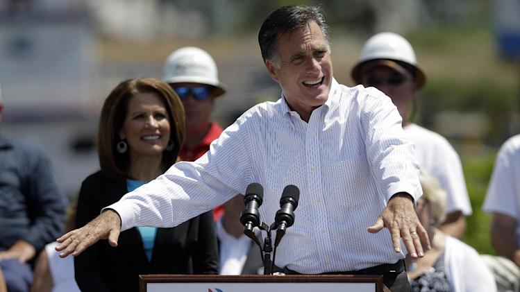 Republican presidential candidate, former Massachusetts Gov. Mitt Romney, accompanied by Rep. Michele Bachmann, R-Minn., speaks at a campaign stop in Portsmouth, Va., Thursday, May 3, 2012. (AP Photo/Jae C. Hong)