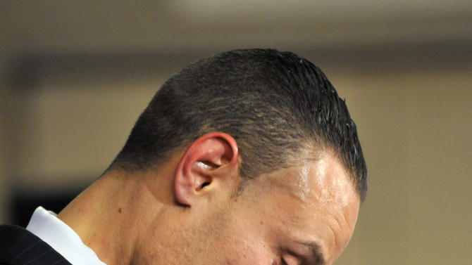 Republican candidate for the U.S. Senate Dan Bongino pauses during his concession speech at the Republican Party election celebration Tuesday, Nov. 6, 2012 in Linthicum, Md. Bongino and independent candidate Rob Sobhani were defeated by Democratic Sen. Ben Cardin. (AP Photo/Gail Burton)