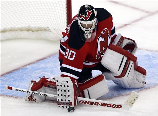 New Jersey Devils goalie Martin Brodeur makes a save on a shot from the Philadelphia Flyers during the third period of an NHL hockey game, Tuesday, Jan. 22, 2013, in Newark, N.J. The Devils won 3-0. (AP Photo/Julio Cortez)