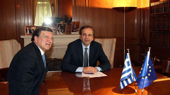 Greece's Prime Minister Antonis Samaras, right, and European Commission President Jose Manuel Barroso attend a meeting at Maximos mansion in Athens, Thursday, July 26, 2012. International debt inspectors started new talks Thursday with the Greek government that will determine whether the country keeps receiving vital rescue loans or is forced to default and potentially leave the common European currency union. (AP Photo/Thanassis Stavrakis)
