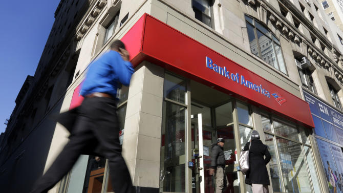 FILE- In this Monday, Jan. 7, 2013 file photo, people pass a Bank of America branch in New York. Bank of America Corp. reports quarterly financial results before the market opens on Wednesday, April 17, 2013. (AP Photo/Richard Drew, File)