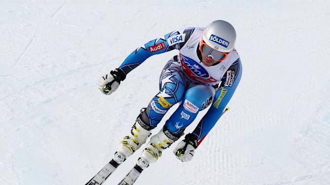 Bode Miller, of the United States, speeds down the course during an alpine ski, Men's World Cup downhill training session in Chamonix, France, Thursday, Feb. 2, 2012. (AP Photo/Alessandro Trovati)