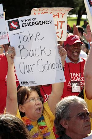FILE -- In this May 13, 2011 file photo,  teachers,. students and supporters demonstrated against proposed budget cuts to education, at the Capitol in Sacramento, Calif., Friday, May 13, 2011.  If approved by voters in November, Proposition 32 would prohibit corporations and unions, like the California Teachers Association,  from collecting money for state political activities from employees or members through paycheck deductions. It also prohibits unions and corporations from making donations to state candidates.(AP Photo/Rich Pedroncelli,File)