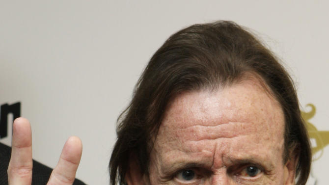 "FILE - In this Nov. 3, 2008 file photo, British Musician Jack Bruce, talks to the media after collecting the Best Album Award given to Cream at the Classic Rock awards in central London. Bruce, best known as the bassist from the 1960s group Cream, has died. He was 71. A statement released by his family announced the death Saturday, Oct. 25, 2014. Publicist Claire Singers said Bruce died at his home in Suffolk, England. Cream, which also included guitarist Eric Clapton and drummer Ginger Baker sold 35 million albums in just over two years and were awarded the world's first ever platinum disc for their album ""Wheels of Fire."" (AP Photo/Joel Ryan)"