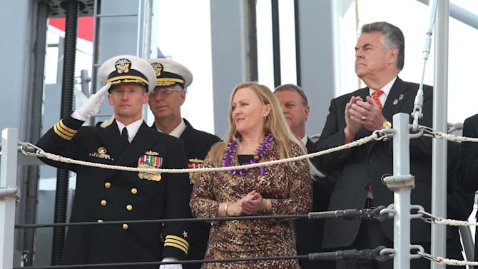 U.S. Navy Commander Thomas Shultz, USS Michael Murphy commanding officer, left, Maureen Murphy, mother of Navy SEAL Lt. Michael P. Murphy, foreground center, Congressman Peter King, right and others take part in the commissioning ceremony for the Navy's newest guided-missile destroyer, the USS Michael Murphy, Saturday Oct. 6, 2012 in New York.  The ship honors Maureen's son, Navy SEAL Lt. Michael P. Murphy, a Long Island native, who became the first American awarded the Medal of Honor during the Afghanistan War when he was killed during an ambush in 2005.  (AP Photo/Tina Fineberg)