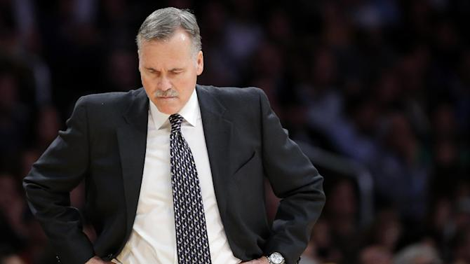 Los Angeles Lakers head coach Mike D'Antoni looks downward in the first half of an NBA basketball game against the Brooklyn Nets in Los Angeles, Tuesday, Nov. 20, 2012. (AP Photo/Jae C. Hong)