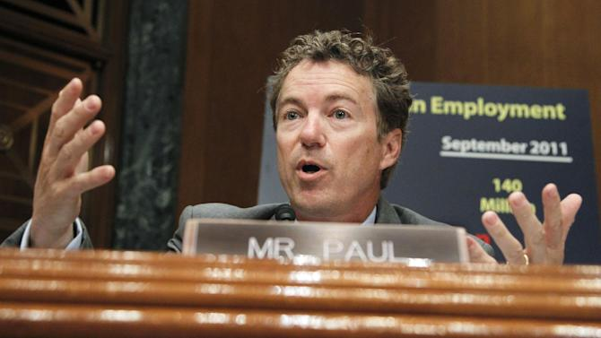 FILE- This Oct. 18, 2011 file photo shows Sen. Rand Paul, R-Ky . speaking on Capitol Hill in Washington. Paul is instituting new approval and citation rules for his staffers and researchers in the face of accusations that he plagiarized material from several sources for speeches, a newspaper column and his book. An adviser confirmed the move as Paul looks to stem the fallout, which includes the Washington Times canceling his column. (AP Photo/Manuel Balce Ceneta, File)