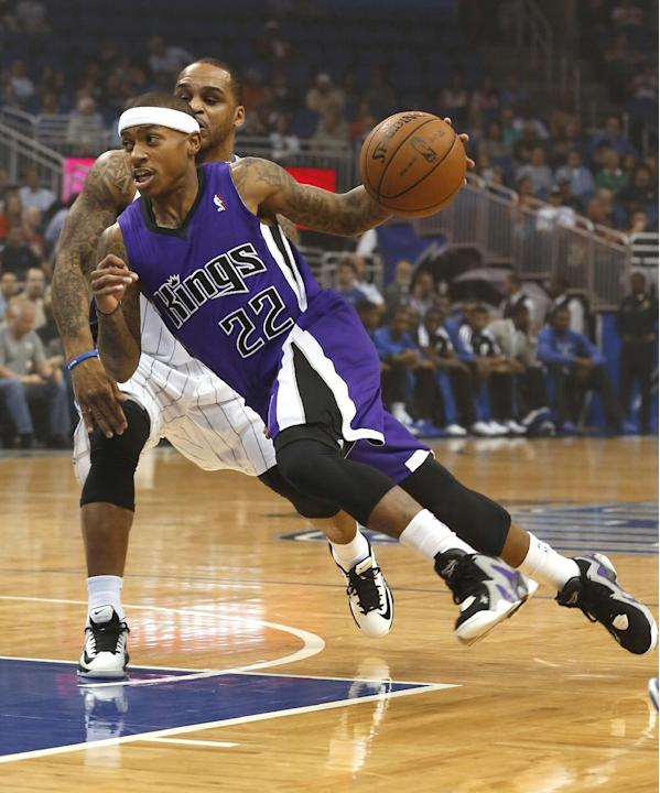 Sacramento Kings guard Isaiah Thomas (22) drives past Orlando Magic guard Jameer Nelson during the first half of an NBA basketball game Saturday, Dec. 21, 2013, in Orlando, Fla
