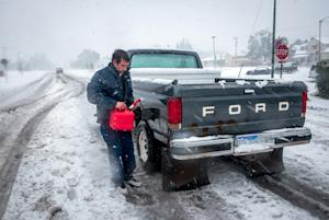 Ronnie Tonuci, 21 of Rapid City, S.D., puts gas in…