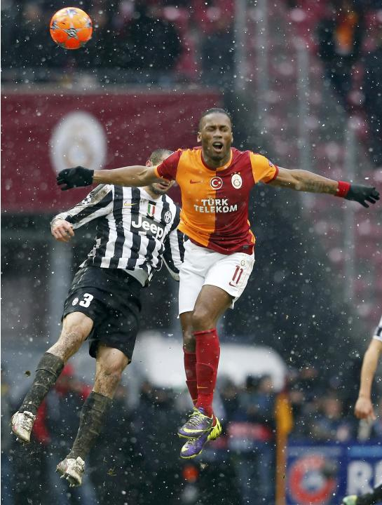 Drogba of Galatasaray jumps for the header with Chellini of Juventus during their Champions League soccer match in Istanbul