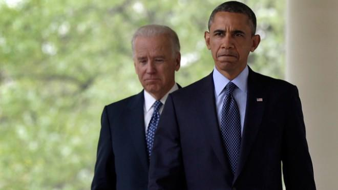 President Obama walks with Vice President Biden before making a statement on the failed gun legislation on April 17.