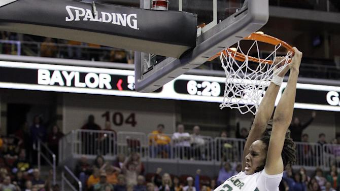 Baylor center Brittney Griner hangs on the rim after dunking the ball during the second half of an NCAA women's tournament regional semifinal college basketball game against Georgia Tech, Saturday, March 24, 2012, in Des Moines, Iowa. (AP Photo/Charlie Neibergall)
